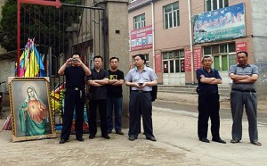 Chinese Undercover Government Police taking pictures of Christians in Donglu